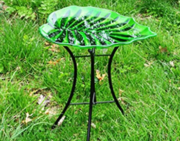 decorative glass bird bath in leaf shape